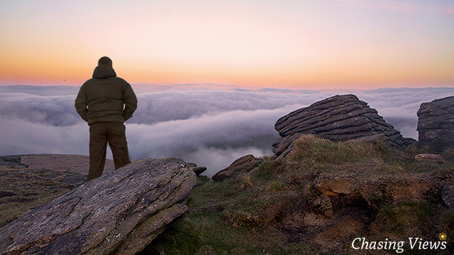 Ash standing above the clouds on Kinder Scout